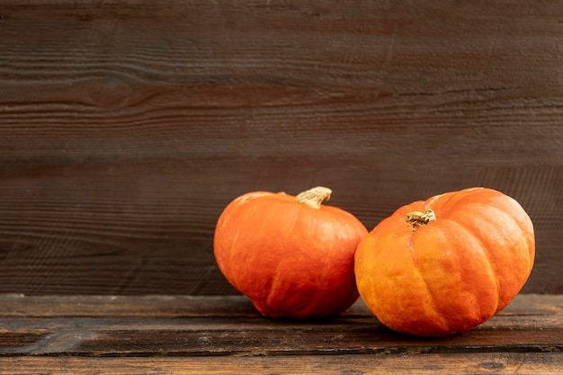 Front view orange pumpkins on wooden table