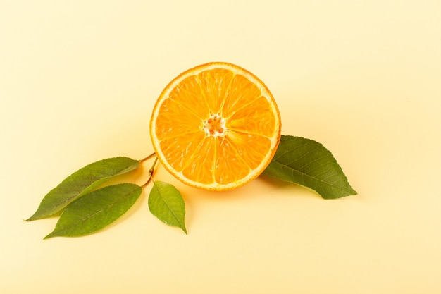A front view orange slice fresh mellow juicy ripe isolated along with green leaves on the cream colored background citrus fruit juice summer