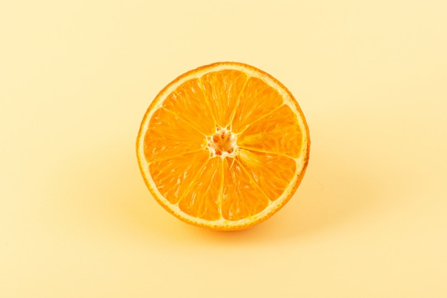A front view orange slice fresh mellow juicy ripe isolated on the cream colored background citrus fruit juice summer
