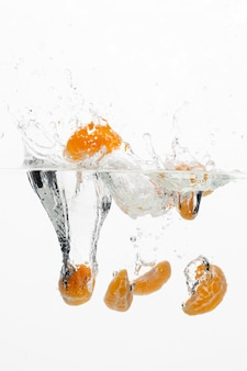 Front view of orange slices in water
