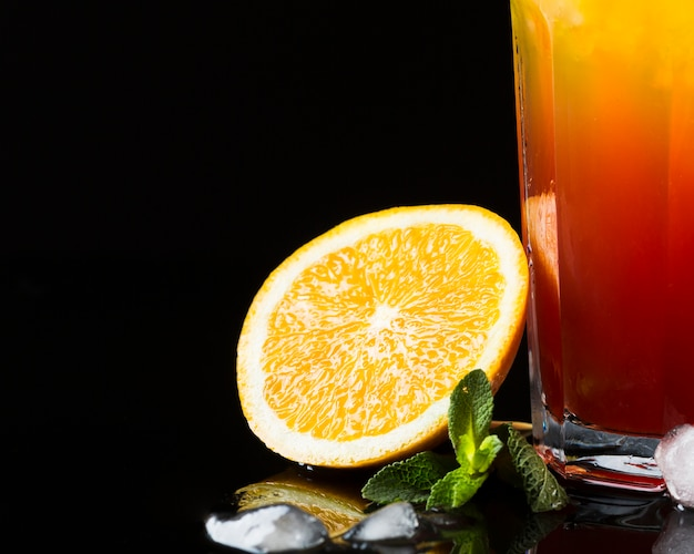Front view of orange with cocktail and mint