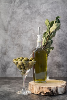 Front view organic olives in a glass
