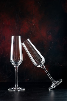 Front view a pair of champagne glasses colliding