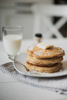 Front view pancakes with milk