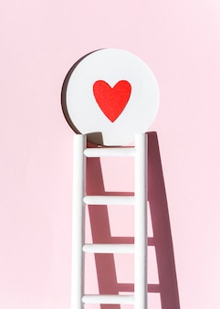 Front view of paper heart with ladder