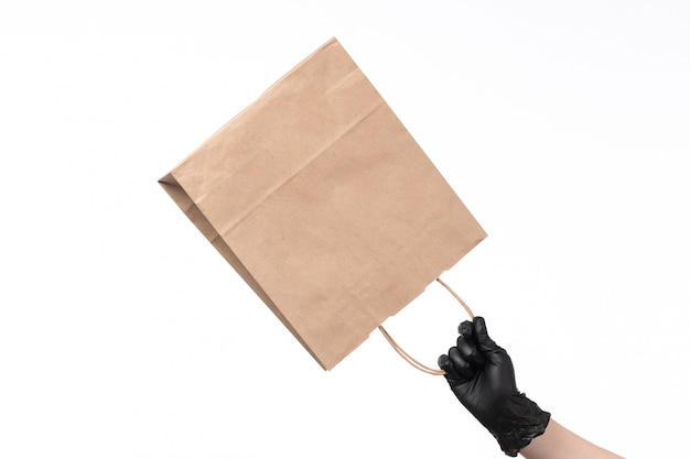 A front view paper package empty hold by female with gloves on white