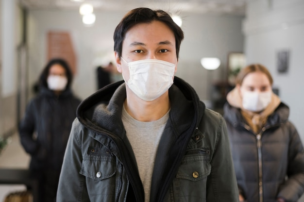 Front view of people with medical masks