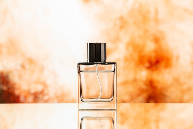 Front view perfume bottle on biege blurred background