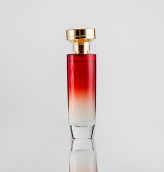 Front view perfume bottle glass model of red color with a gold plastic cover