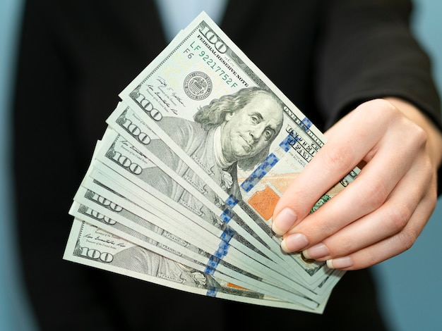 Front view of person holding money