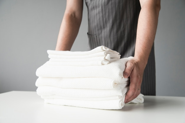 Front view person holding towels