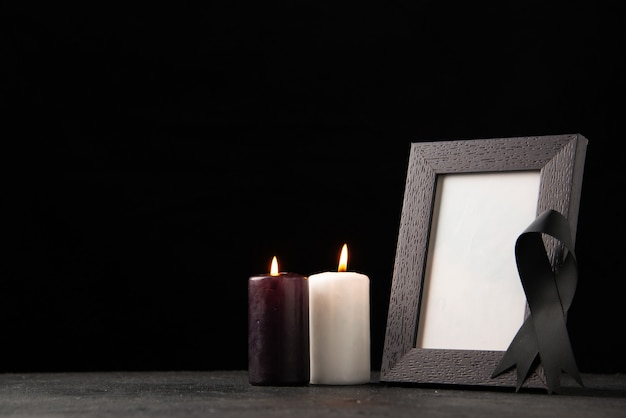 Front view of picture frame with candles on black