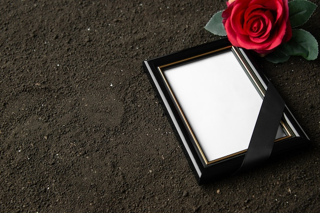 Front view of picture frame with red flower on black