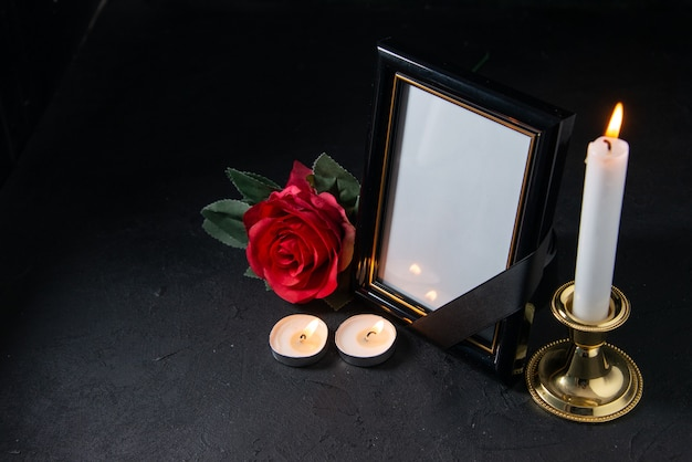 Front view of picture frame with red flower on the black