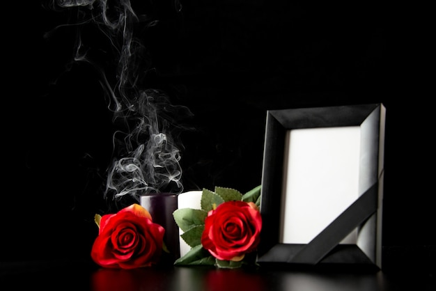 Front view of picture frame with red flowers on black
