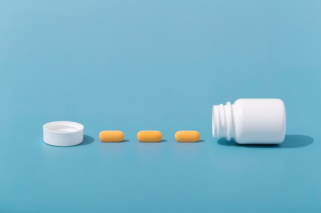 Front view of pills in row with container