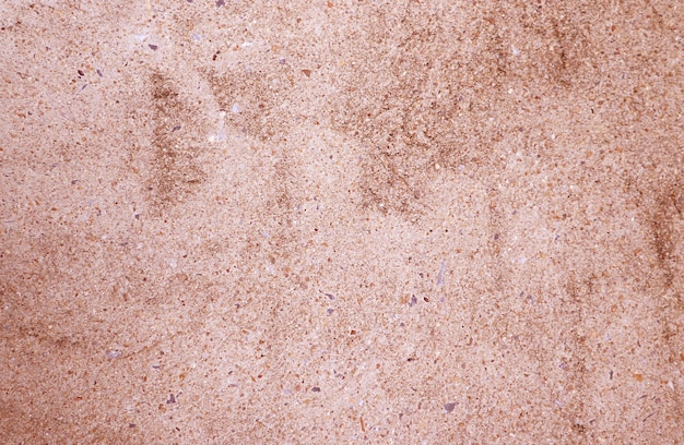 Front view of pink brown colored grunge concrete wall