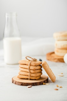 Front view of plain biscuits next to milk
