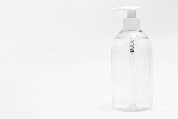 Front view of plastic bottle with liquid soap and copy space