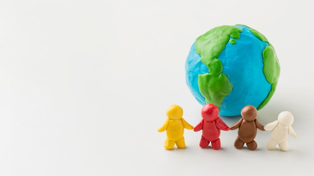 Front view of plasticine earth with people