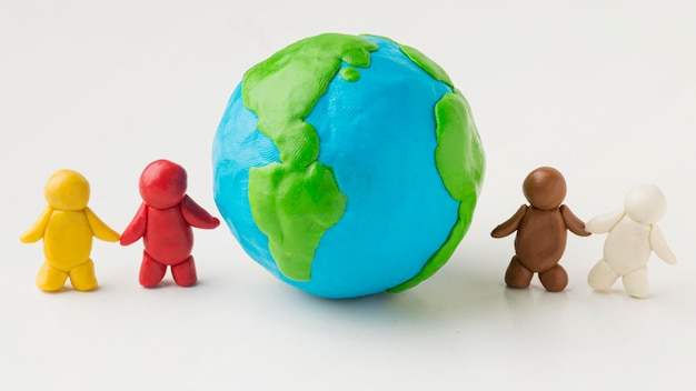 Front view of plasticine people with globe