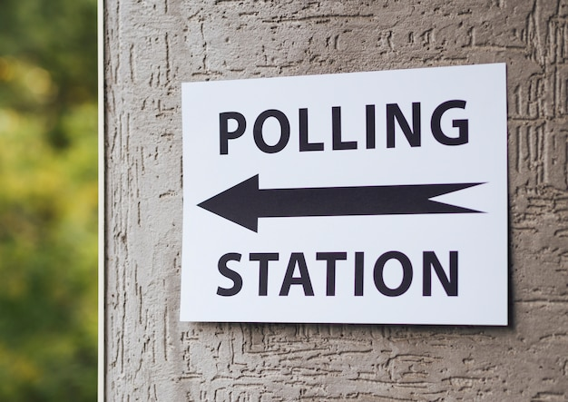 Front view polling station sign with direction
