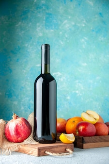 Front view pomegranate wine on a blue wall drink fruit alcohol sour color bar restaurant juice wine