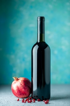 Front view pomegranate wine on the blue wall drink fruit alcohol wine sour color juice bar restaurant