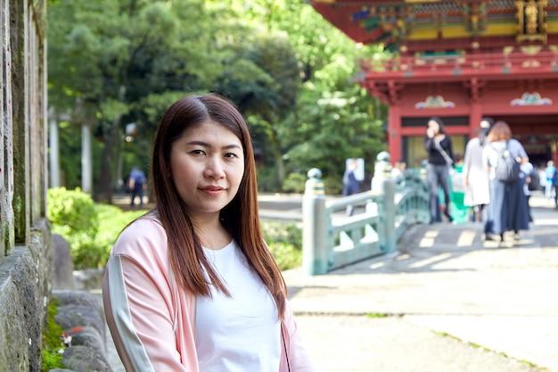Front view portrait of a happy woman tourist