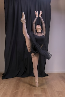 Front view pose with arms and one leg up