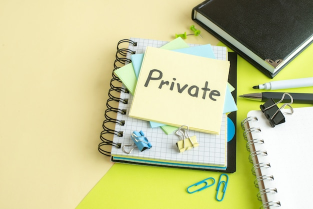 Front view private written note with stickers and notepad on green background