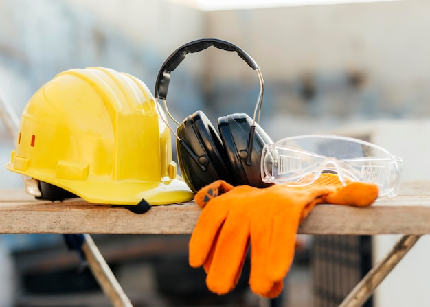 Front view of protective glasses with hard hat and headphones