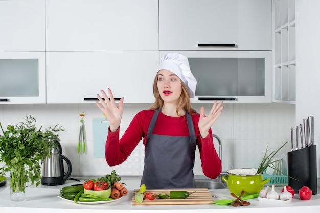 Front view puzzled female chef in cook hat