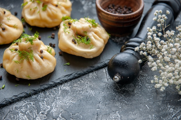 Front view raw little dumplings with tomato sauce on gray table cooking dinner dish meat cuisine meal cake dough