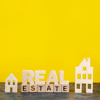 Front view real estate lettering on yellow background