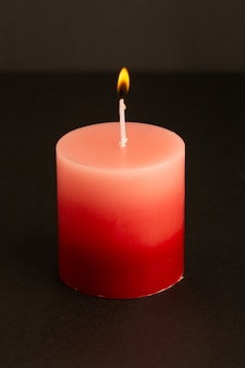 A front view red candle lighting isolated melting light fire flame