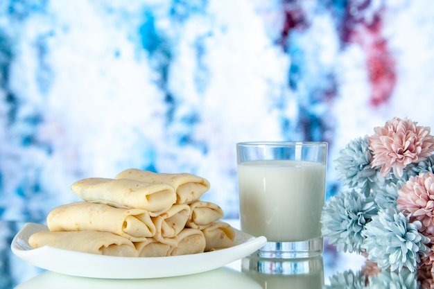 Front view rolled sweet pancakes with glass of milk on light background meal breakfast food sugar flower color cake morning pie
