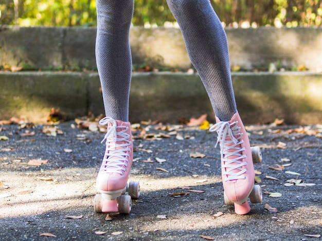 Front view of roller skates with legs in socks