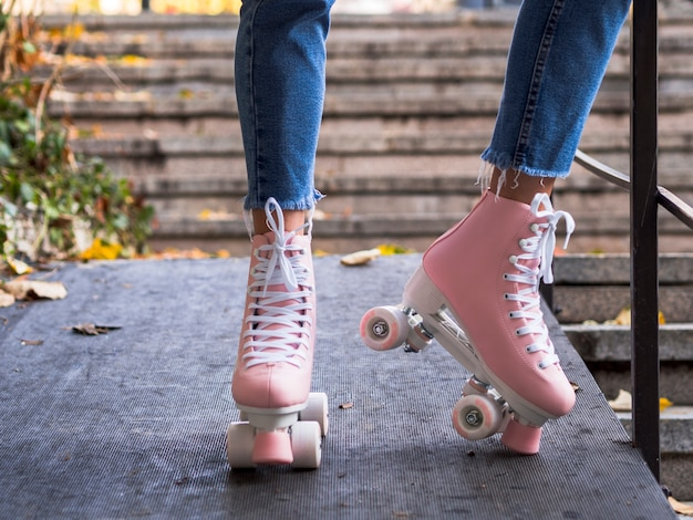 Front view of roller skates on woman in jeans