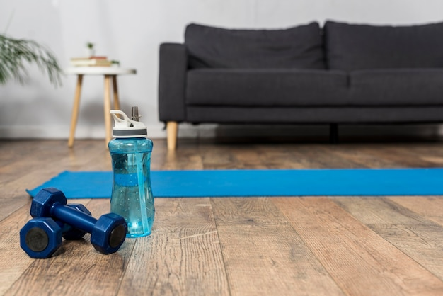 Front view of room with weights and water bottle