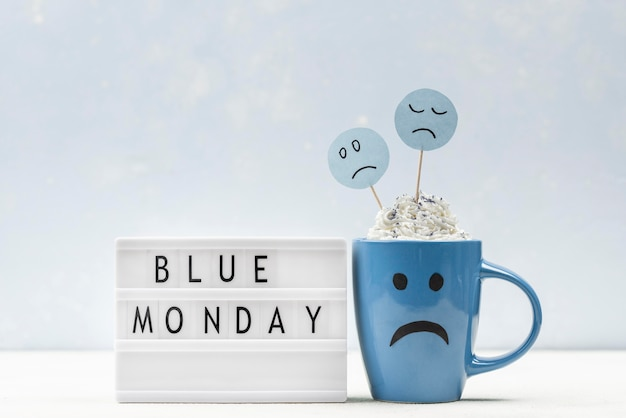 Front view of sad mug with light box for blue monday