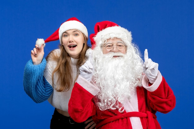 Front view santa claus along with young female on blue human christmas color new year holidays