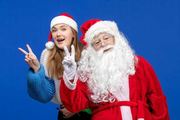 Front view santa claus along with young female on blue human xmas color new year holiday