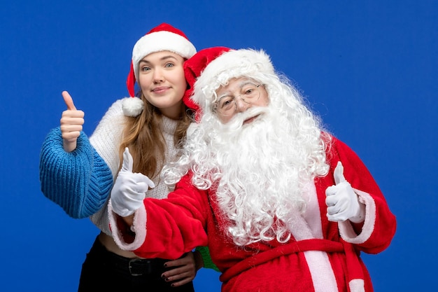 Front view santa claus along with young female on blue human xmas color new year holidays