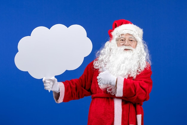 Front view santa claus holding big cloud shaped sign on a blue snow color christmas