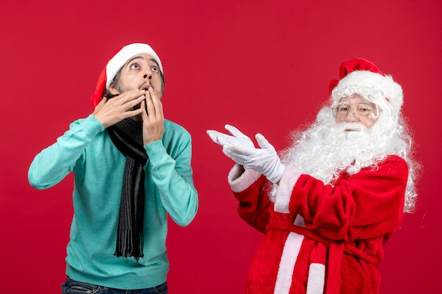 Front view santa claus with young male just standing