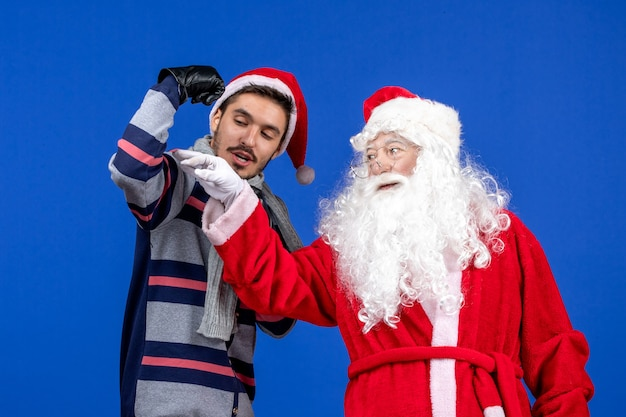 Front view santa claus with young male