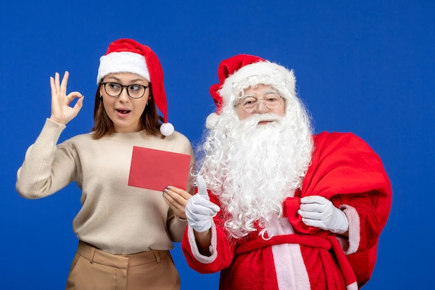 Front view santa claus and young female holding letter on a blue holiday xmas new year color emotion