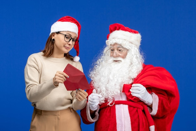 Front view santa claus and young female opening letter on blue emotion christmas new year color