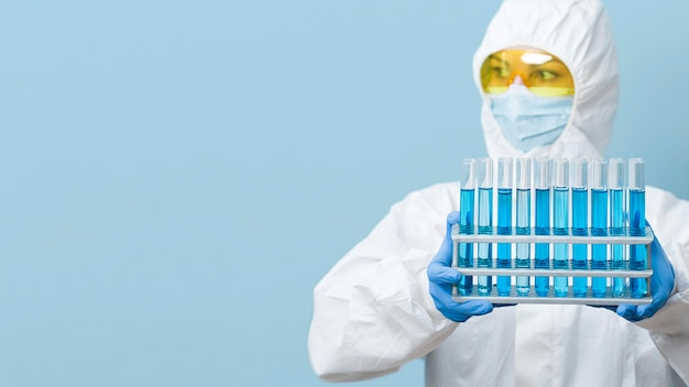 Front view scientist holding blue chemicals with copy space